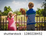 kids   boy and girl looking at... | Shutterstock . vector #1280228452