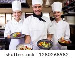 group of chefs holding plate of ... | Shutterstock . vector #1280268982