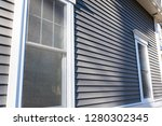 vinyl siding and windows on new ... | Shutterstock . vector #1280302345