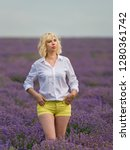 young girl posing in a lavender ... | Shutterstock . vector #1280361742