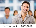 happy business man with a group ... | Shutterstock . vector #128038892