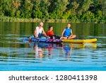 joyful friends  a sup surfers...   Shutterstock . vector #1280411398