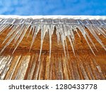 icicles hanging from the edge... | Shutterstock . vector #1280433778