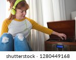 woman listening to music on... | Shutterstock . vector #1280449168