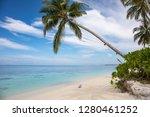 cute baby on a beach on an... | Shutterstock . vector #1280461252