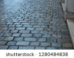 wet cobbles in the old town   Shutterstock . vector #1280484838