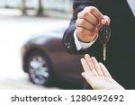 car key  businessman handing... | Shutterstock . vector #1280492692