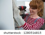 young female carpenter using... | Shutterstock . vector #1280516815