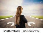 businesswoman at a crossroads.... | Shutterstock . vector #1280539942