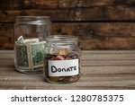donation jars with money on... | Shutterstock . vector #1280785375