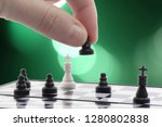 chess player plays with the pawn   Shutterstock . vector #1280802838