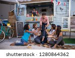 man passing beer bottles to his ... | Shutterstock . vector #1280864362