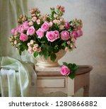 delicate pink roses in a... | Shutterstock . vector #1280866882