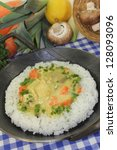Small photo of a pan with rice and colorful chicken fricassee