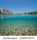 spain beach with an hotel in... | Shutterstock . vector #1280953975