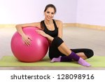 young woman with gym ball at... | Shutterstock . vector #128098916