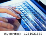 closeup of male hands typing on ... | Shutterstock . vector #1281021892