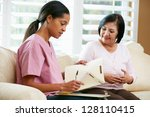 nurse discussing records with... | Shutterstock . vector #128110415
