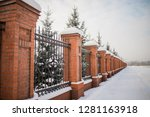 metal fence made of bricks.... | Shutterstock . vector #1281163918