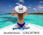 back view of the young woman... | Shutterstock . vector #1281297805