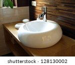 closeup of round white sink in... | Shutterstock . vector #128130002