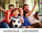 excited family watching... | Shutterstock . vector #1281363202