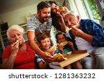 multi generation family eating... | Shutterstock . vector #1281363232