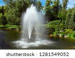 decorative pond with fountain... | Shutterstock . vector #1281549052