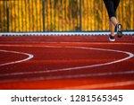 red running track with runner's ... | Shutterstock . vector #1281565345