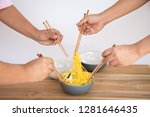 close up people eat yellow stir ... | Shutterstock . vector #1281646435