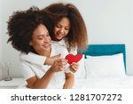 mother and daughter enjoying on ... | Shutterstock . vector #1281707272