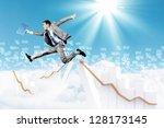 image of a businessman jumping...   Shutterstock . vector #128173145