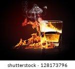 image of glass of burning...   Shutterstock . vector #128173796