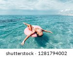 child chilling on lilo in the... | Shutterstock . vector #1281794002