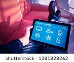controlling smart home... | Shutterstock . vector #1281828262