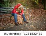 Mature Woman With Alsatian Dog...