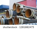 piled up irrigation pipes with... | Shutterstock . vector #1281882475