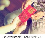 Small photo of Lunar New Year celebrations theme people giving red envelope. The 1st chinese sentence is how we Chinese always wish people Happy Chinese New Year. The 2nd means all things going smooth and well.