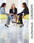 Three Businesswomen Meeting...