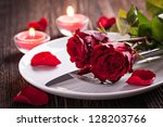 table setting for valentines day with roses - stock photo
