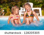 two little girls playing in the ... | Shutterstock . vector #128205305