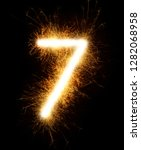 number 7 drawn with spaklers on ... | Shutterstock . vector #1282068958