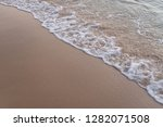 wet sand on the long beach  phu ... | Shutterstock . vector #1282071508