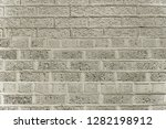 old grey brick wall background... | Shutterstock . vector #1282198912
