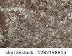 brown granite rock background... | Shutterstock . vector #1282198915