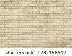 old beige brick wall background ... | Shutterstock . vector #1282198942