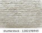old grey brick wall background... | Shutterstock . vector #1282198945