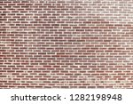 old red brick wall background... | Shutterstock . vector #1282198948