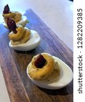 three deviled eggs served on a... | Shutterstock . vector #1282209385
