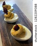 three deviled eggs served on a... | Shutterstock . vector #1282209388